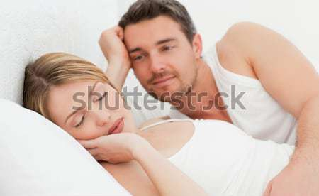 Handsome Man kissing his wife on the cheek in the bedroom Stock photo © wavebreak_media