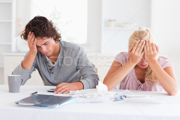 Sad couple while accounting in their living room Stock photo © wavebreak_media
