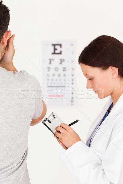 Női optikus beteg látásvizsgálat mosoly férfi Stock fotó © wavebreak_media