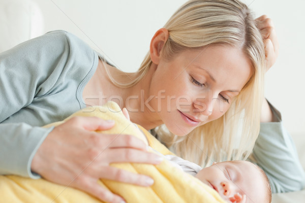 Young mother relaxing next to her baby Stock photo © wavebreak_media