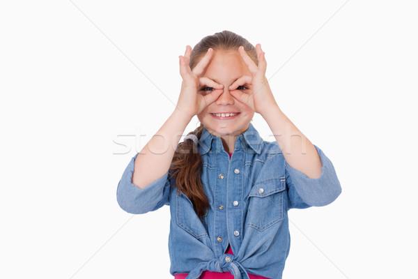девушки пальцы вокруг глазах белый лице Сток-фото © wavebreak_media