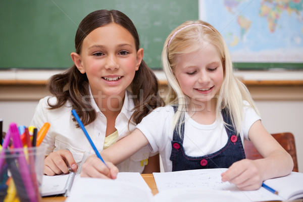 Pupils working together on an assignment in a classroom Stock photo © wavebreak_media