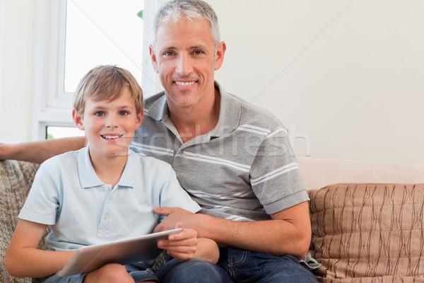 улыбаясь отцом сына гостиной семьи дома Сток-фото © wavebreak_media
