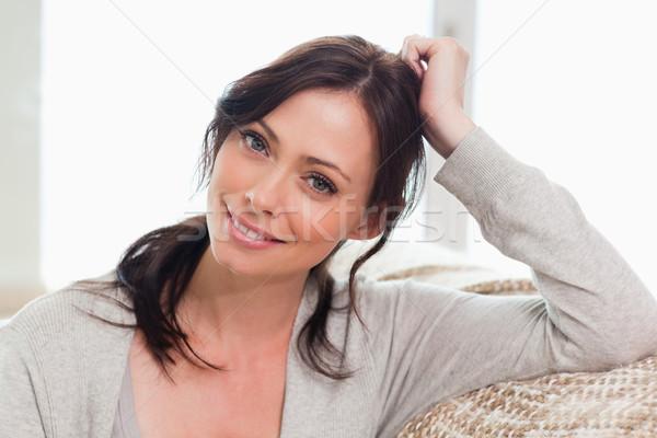 Magnifico donna posa soggiorno sorriso moda Foto d'archivio © wavebreak_media