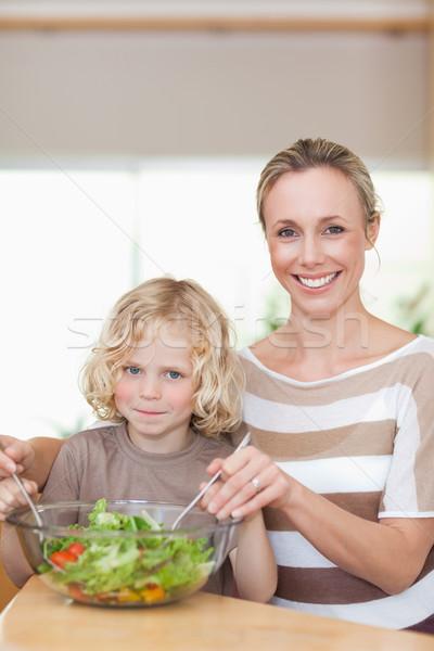 Smiling mother and son stirring salad together Stock photo © wavebreak_media