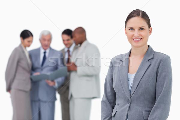 Mosolyog elarusítónő csapat mögött fehér üzlet Stock fotó © wavebreak_media