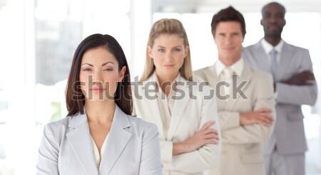 Elarusítónő kollégák mögött fehér üzletember öltöny Stock fotó © wavebreak_media