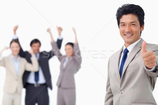 Businessman giving thumb up white getting celebrated against a white background Stock photo © wavebreak_media