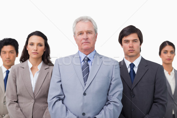Mature businessman standing with his team against a white background Stock photo © wavebreak_media