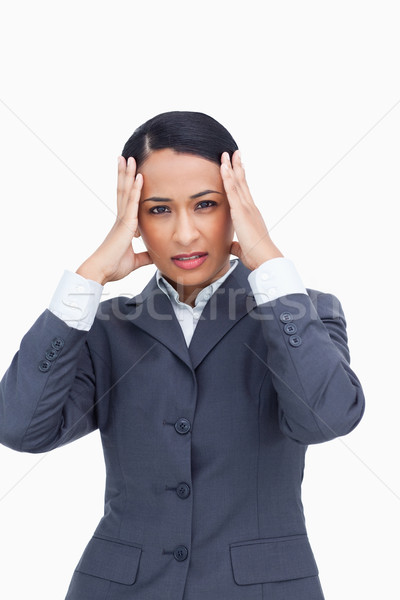 Close up of saleswoman experiencing a headache against a white background Stock photo © wavebreak_media