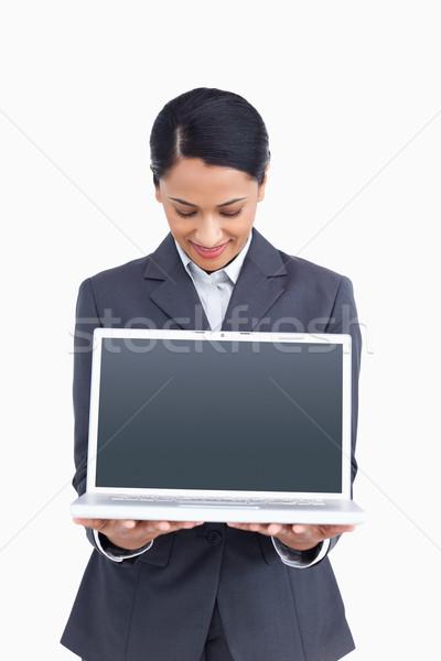 Közelkép elarusítónő bemutat képernyő laptop fehér Stock fotó © wavebreak_media