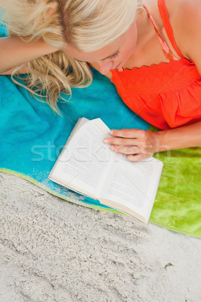 Overhead view of a blonde woman reading a book Stock photo © wavebreak_media