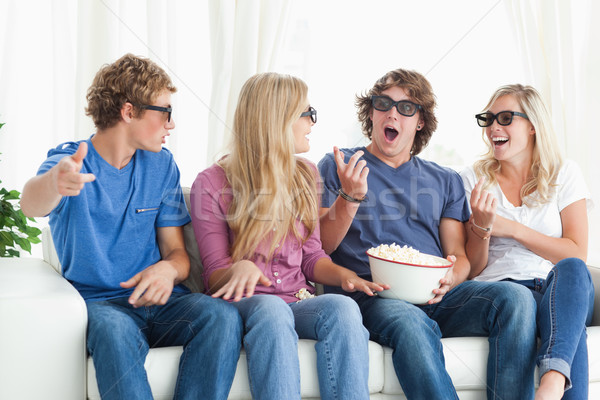 A group of friends laugh and joke around as they wear 3d glasses Stock photo © wavebreak_media