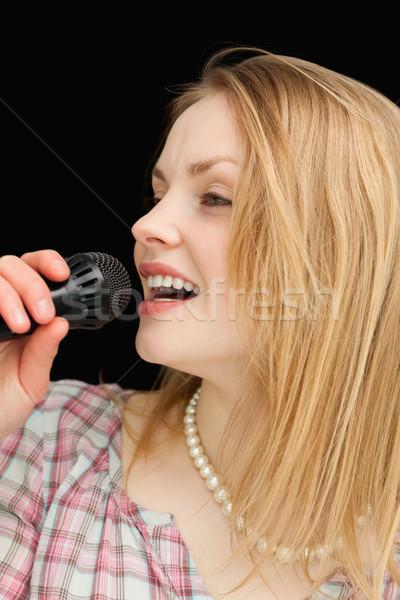 женщину пения черный стороны микрофона женщины Сток-фото © wavebreak_media