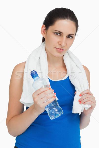 Bruna indossare abbigliamento sportivo asciugamano bottiglia bianco Foto d'archivio © wavebreak_media