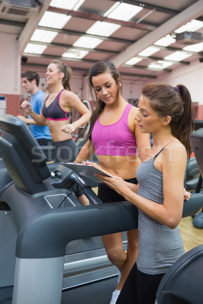 Female gym instructor and woman in the gym on the treadmill Stock photo © wavebreak_media