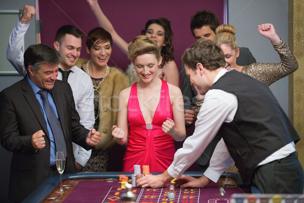 People cheering at roulette table in casino Stock photo © wavebreak_media