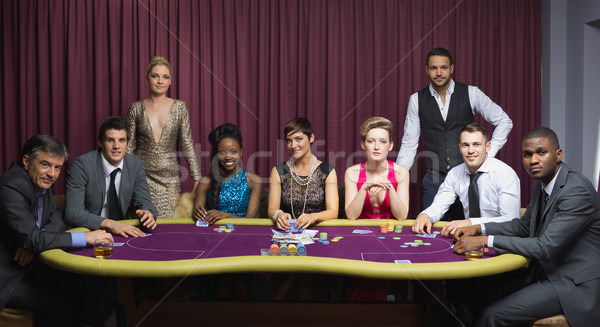 Well-dressed group at poker table in casino Stock photo © wavebreak_media