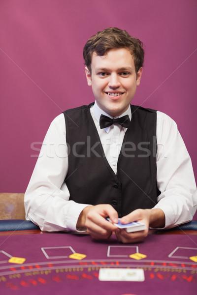 Satıcı oturma tablo kumarhane kartları Stok fotoğraf © wavebreak_media