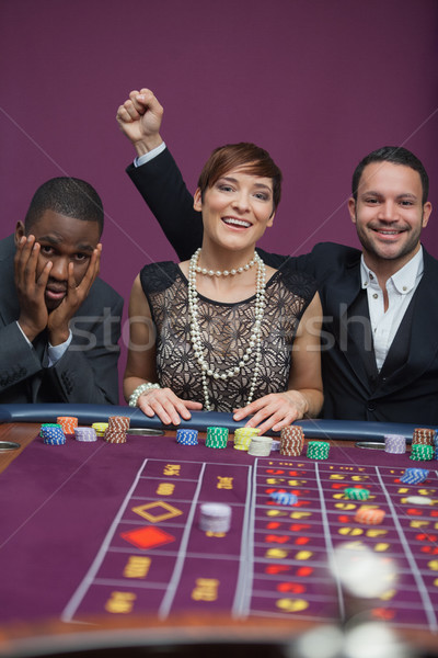 Two winners and a loser at roulette in casino Stock photo © wavebreak_media
