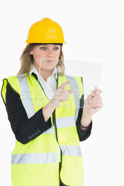 Female architect pressing something while holding the pane Stock photo © wavebreak_media