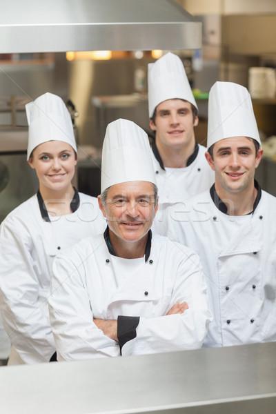Boldog csapat séfek áll konyha munka Stock fotó © wavebreak_media