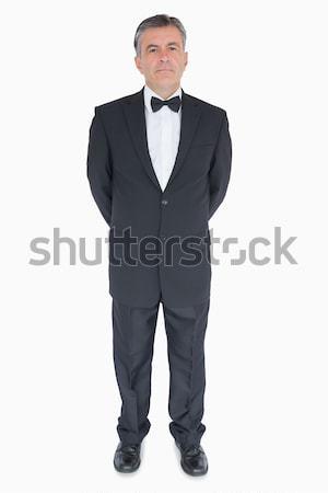 Man in suit standing with hands behind his back Stock photo © wavebreak_media