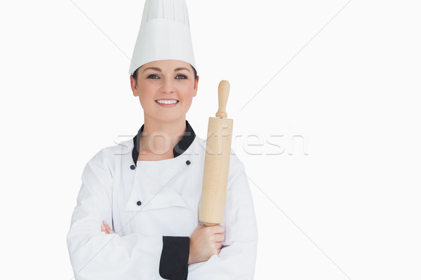 Happy cook holding a rolling pin on white background Stock photo © wavebreak_media