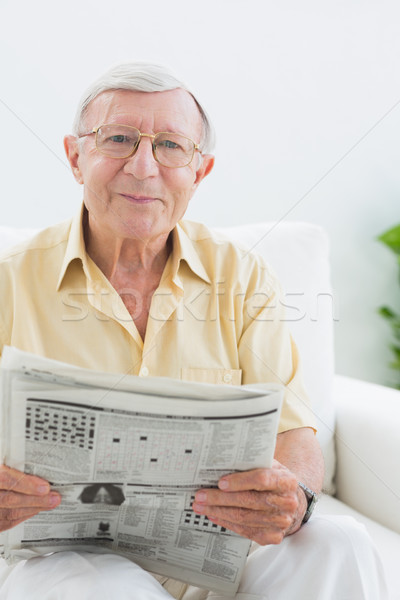 улыбаясь пожилого человека чтение Новости гостиной Сток-фото © wavebreak_media
