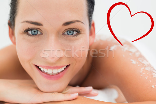 Composite image of peaceful brunette lying with salt scrub on ba Stock photo © wavebreak_media