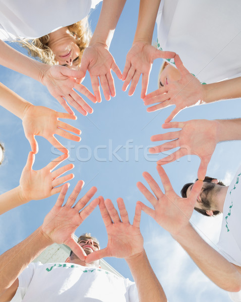 Eller birlikte mavi gökyüzü görmek Stok fotoğraf © wavebreak_media