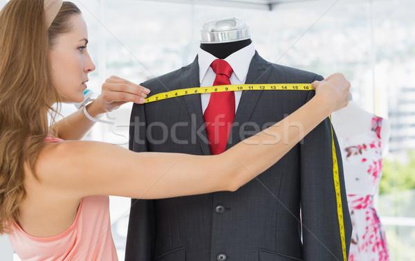 Női divat designer mér öltöny oldalnézet Stock fotó © wavebreak_media
