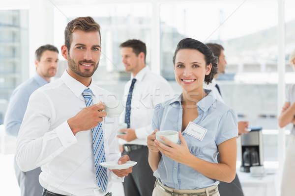 Negocios colegas tazas de té romper retrato brillante Foto stock © wavebreak_media
