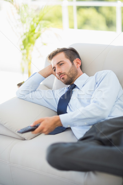 Relaxed well dressed man watching tv in living room Stock photo © wavebreak_media