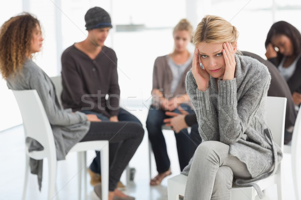 Upset woman with head in hands at rehab group looking at camera Stock photo © wavebreak_media