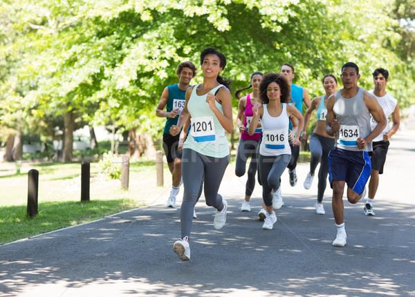 Maratón atletas ejecutando grupo calle árbol Foto stock © wavebreak_media