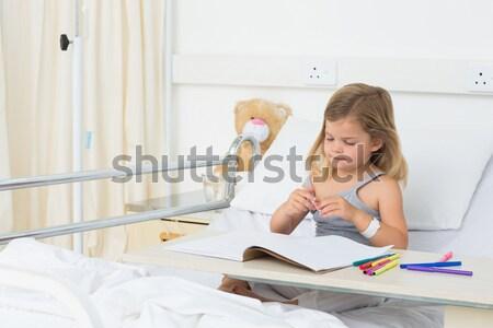 Portrait of girl coloring book in hospital Stock photo © wavebreak_media