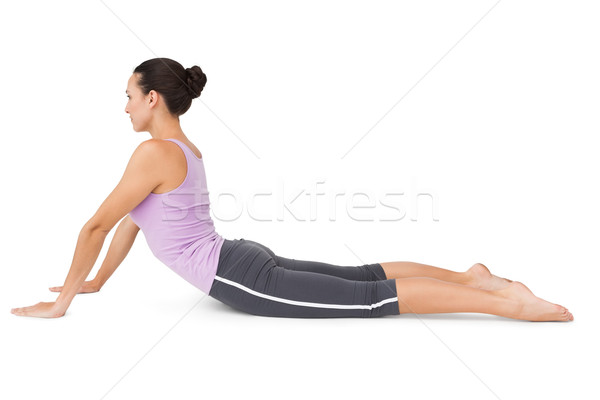 Side view of a fit young woman doing the cobra pose Stock photo © wavebreak_media