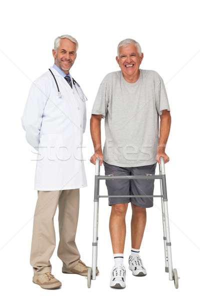 Portrait of a doctor with senior man using walker Stock photo © wavebreak_media