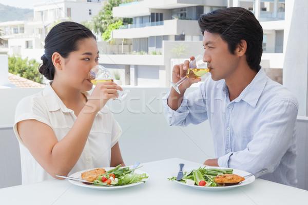 Feliz casal refeição juntos vinho branco fora Foto stock © wavebreak_media