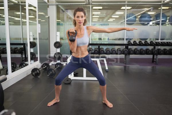 соответствовать женщину гири спортзал спорт Сток-фото © wavebreak_media