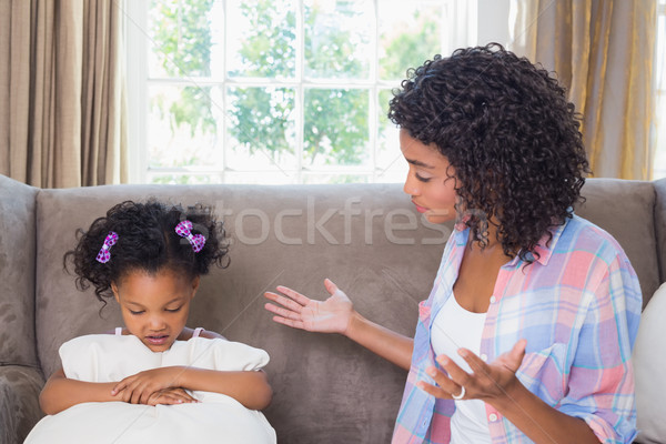 Pretty mother scolding her daughter on the couch Stock photo © wavebreak_media