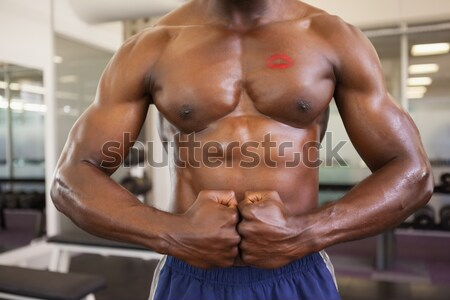 Muscular man exercising with dumbbell in gym Stock photo © wavebreak_media