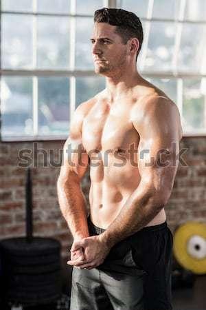 Shirtless muscular man posing in gym Stock photo © wavebreak_media