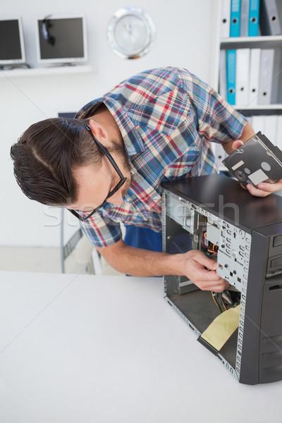 Computer engineer working on broken console Stock photo © wavebreak_media