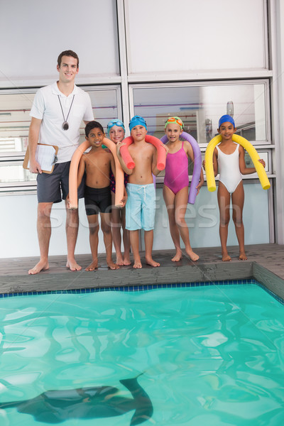 Natación entrenador estudiantes ocio centro agua Foto stock © wavebreak_media