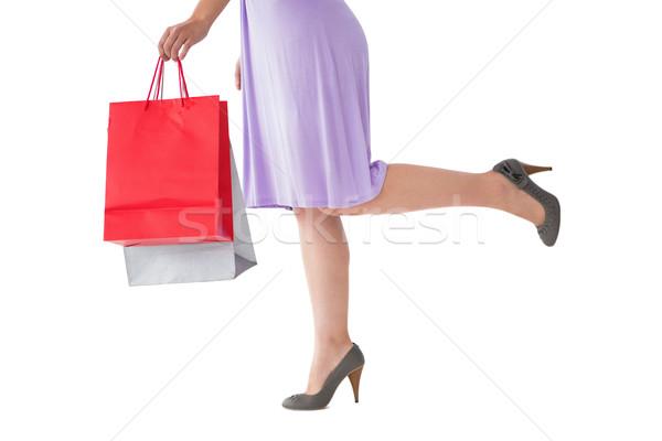 Frau Kleid halten Einkaufstasche weiß Stock foto © wavebreak_media