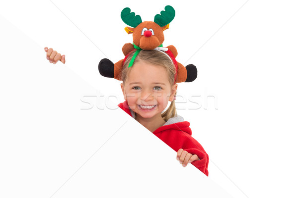 Festive little girl showing poster Stock photo © wavebreak_media