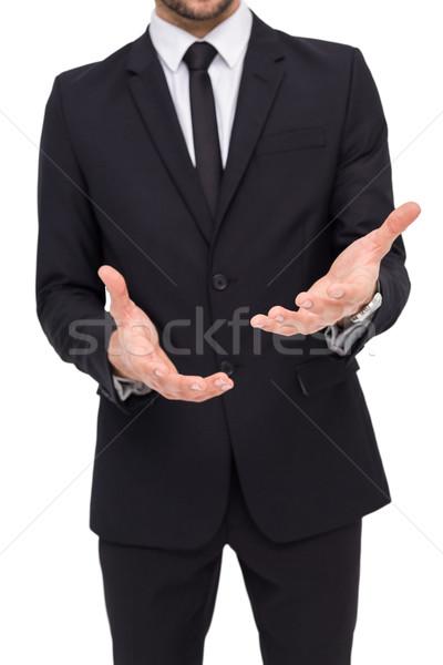 Középső rész üzletember mutat kezek fehér öltöny Stock fotó © wavebreak_media