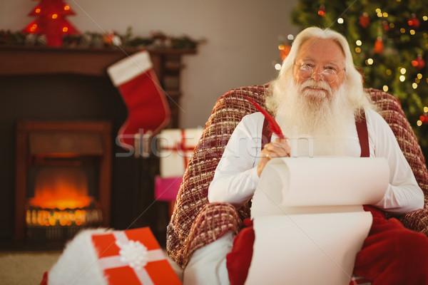 笑みを浮かべて サンタクロース 書く リスト アームチェア ホーム ストックフォト © wavebreak_media